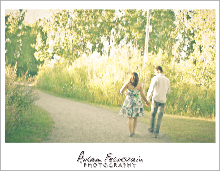 Khizr & Adriana walking along a path - Montreal Engagement Photography